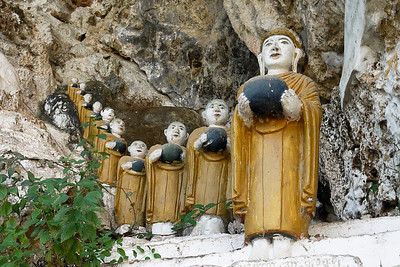 Buddhas line the caves and rocks in Hpa-An, Burma.