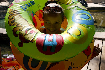 Ana plays with the floaties near the Kawkathaung cave outside of Hpa-An, Burma.