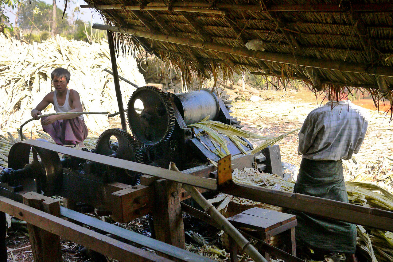 The sugarcane press is a huge handmade machine that squeezes the juice from the sugarcane stalks on Inle Lake, Burma (Myanmar).
