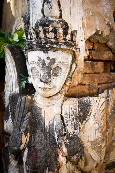 A figure is still carved into the ruins at Shwe Inn Tain Pagoda, on Inle Lake, Burma (Myanmar).