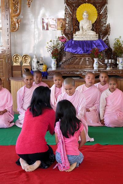 Donations to a monastery in Nyaung Shwe on Inle Lake, Burma (Myanmar).