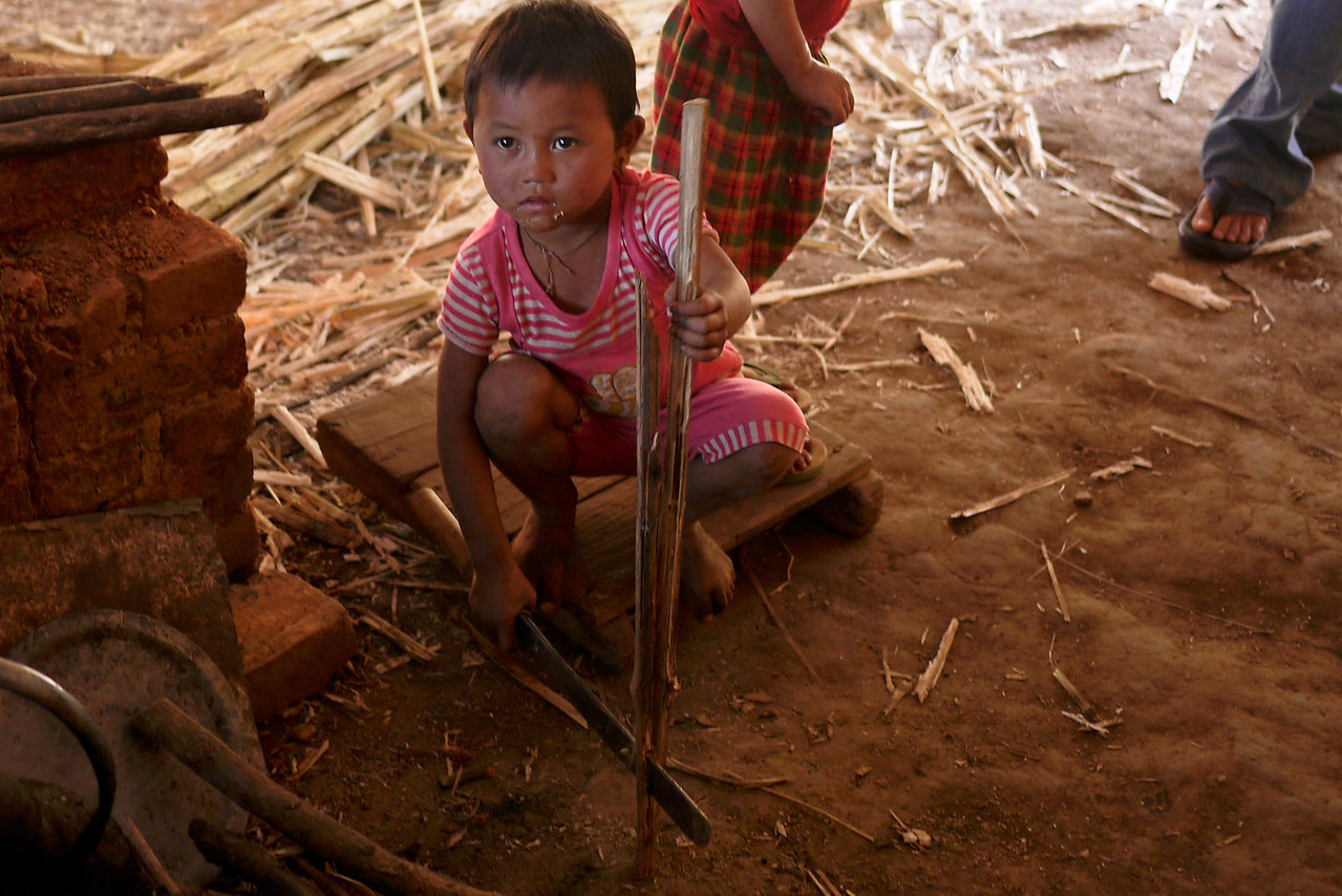 Need a machete? This little girl has it covered, Inle Lake, Burma (Myanmar).