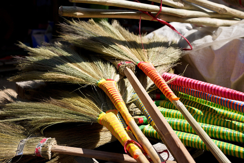 Colorful brooms for sale at the morning market on Inle Lake, Burma (Myanmar).
