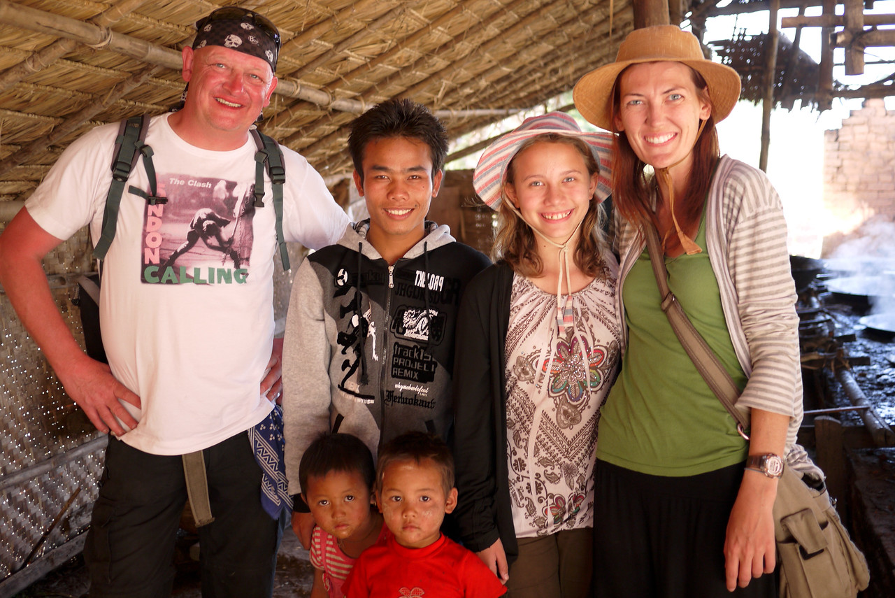 Our translator, a cousin to the candy makers, takes a moment to smile with us before we head out, Inle Lake, Burma (Myanmar).