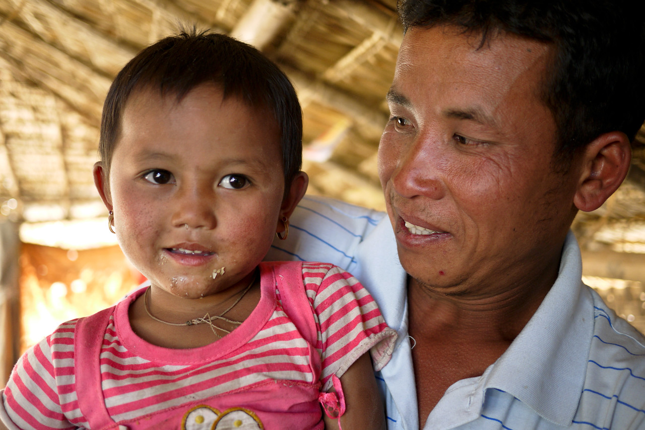 A father and daughter at the candy making house near Inle Lake, Burma (Myanmar).