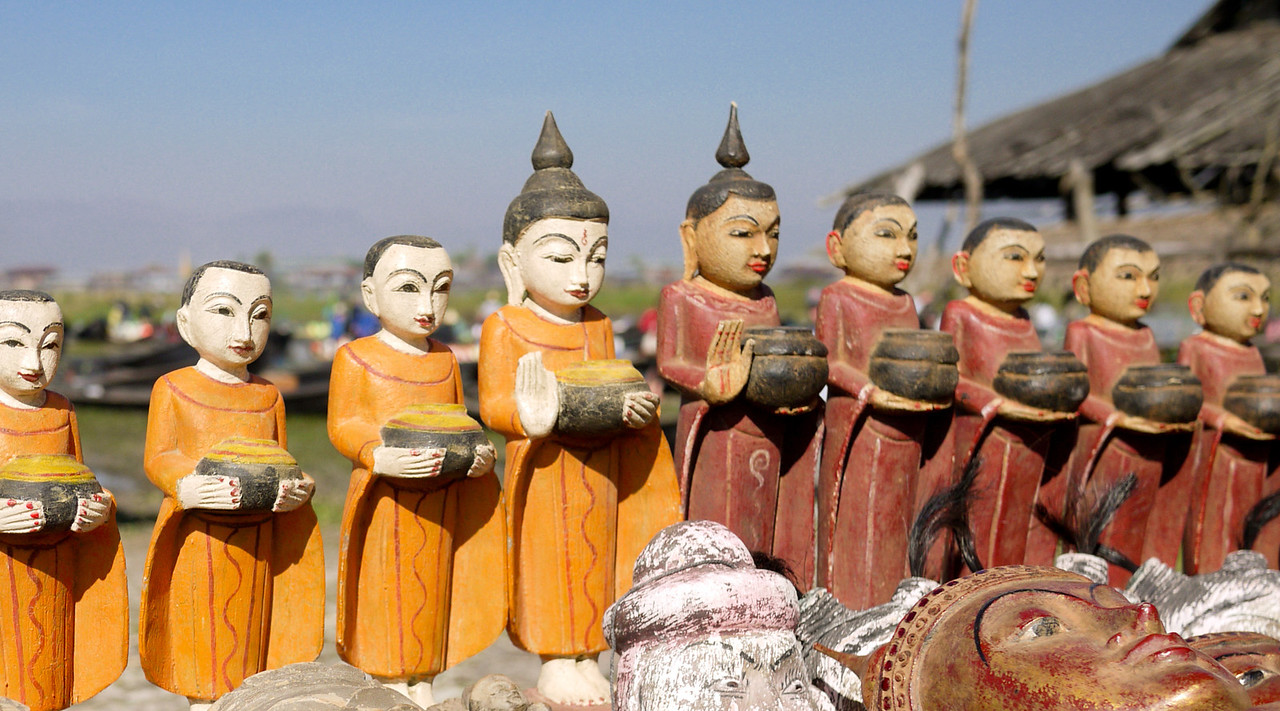 A line of monk figurines for sale at the morning market on Inle Lake, Burma (Myanmar).