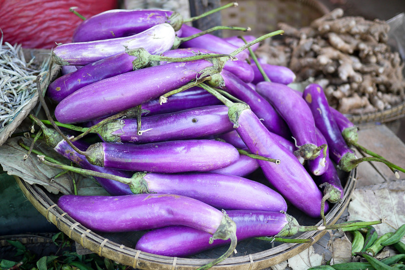 Bright purple eggplants at the market in Nyaung Shwe, near Inle Lake, Burma (Myanmar).