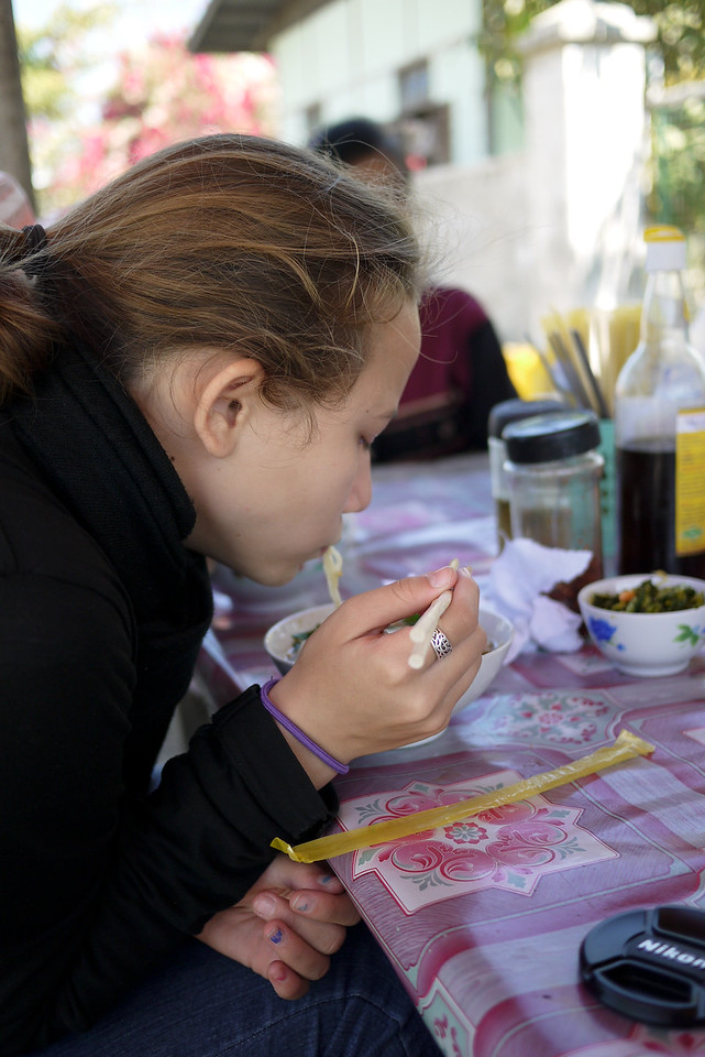 Ana chows down on the street food in Nyaung Shwe on Inle Lake, Burma (Myanmar).