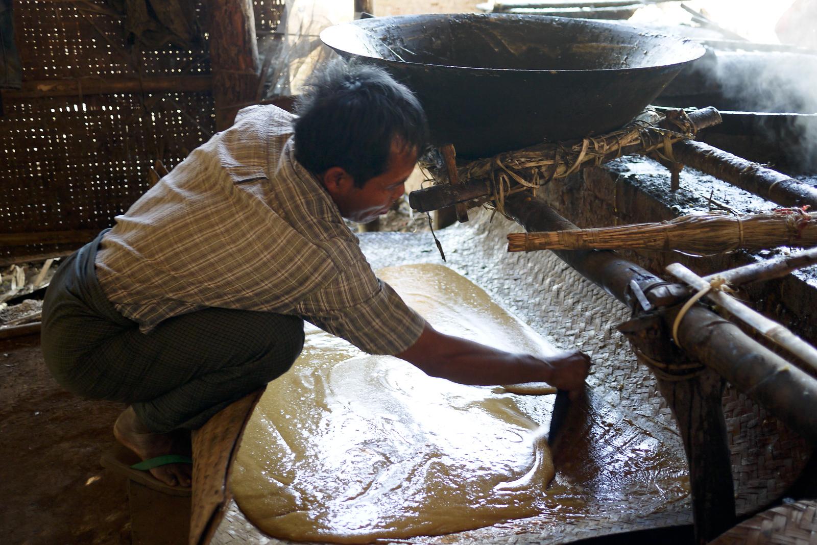 Spreading the boiled sugarcane juice, Inle Lake, Burma (Myanmar).