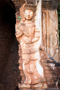 A dancing lady relief is carved into the red stones at Shwe Inn Tain Pagoda, Inle Lake, Burma (Myanmar).