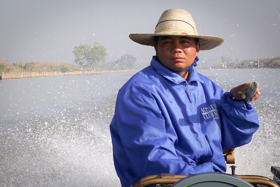 Boat driver on Inle Lake, Burma (Myanmar).