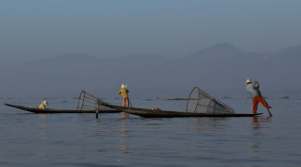 Fishermen and their iconic, traditional conical nets Inle Lake, Burma (Myanmar).