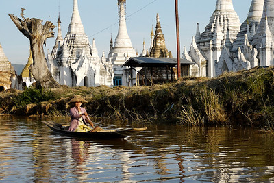 Paddling home at sunset on Inle Lake, Burma (Myanmar).