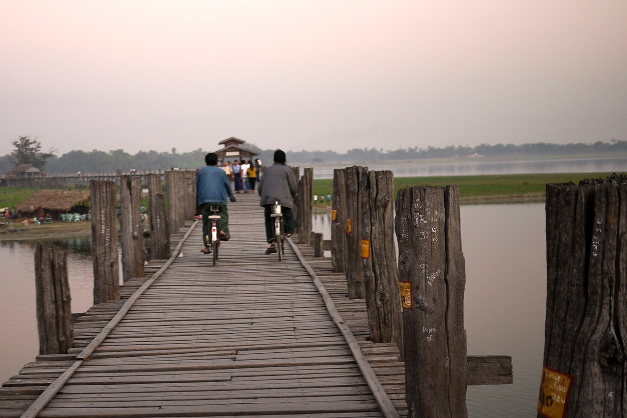 Bikes and a sunset on U Bein Bridge near Mandalay, Burma.
