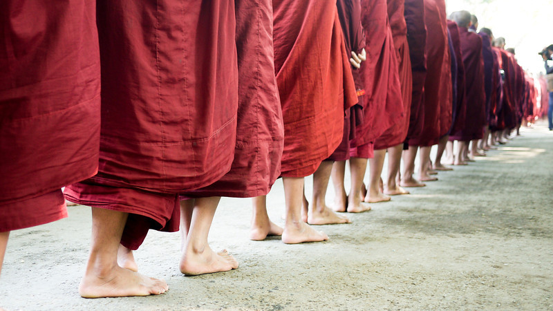 A line of monks at the Maha Gandayon Monastery in Mandalay, Myanmar.