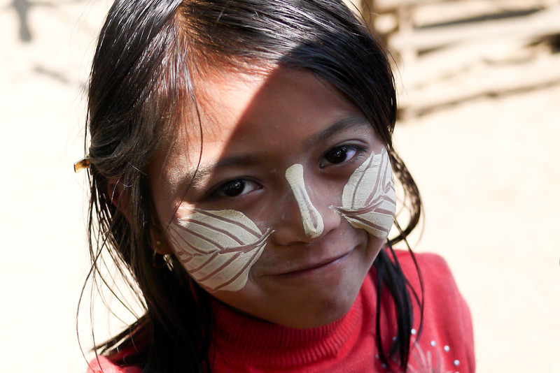 Beautiful thanaka on the face of a young girl in Mandalay, Burma.