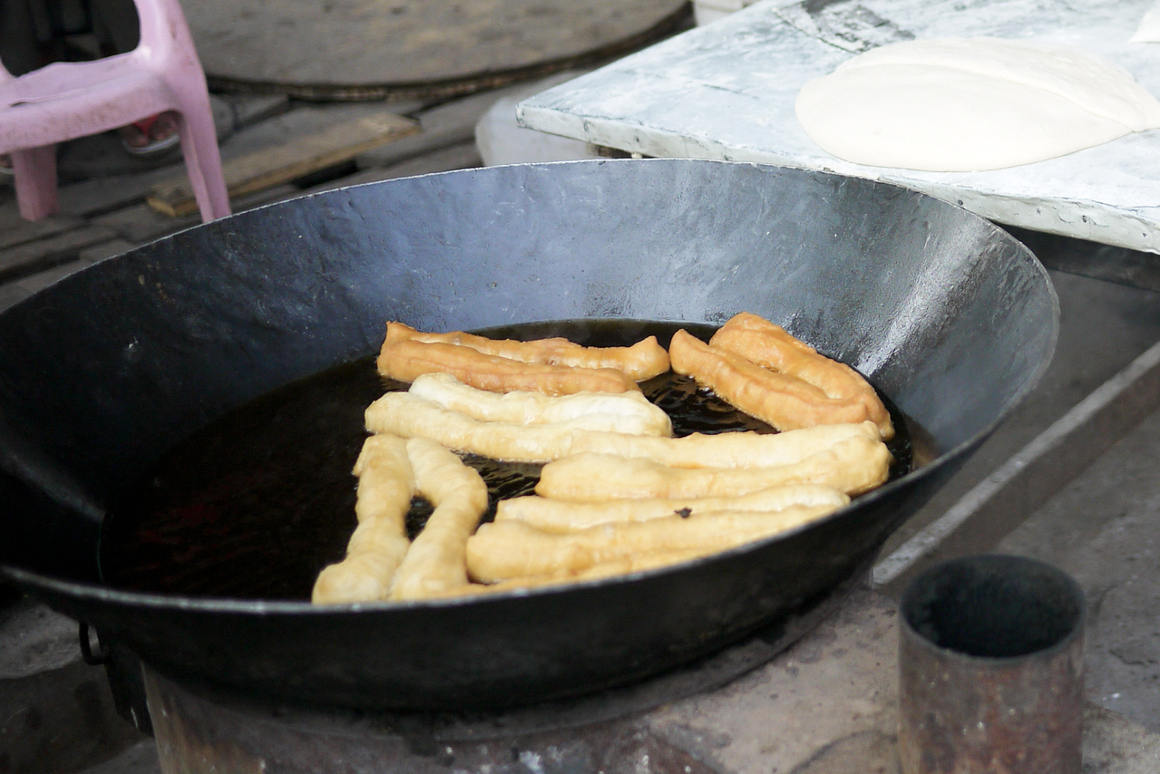 Fresh fried dough from a street vendor in Mandalay was a special treat one morning!