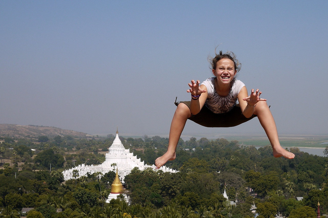 Jumping for all we're worth overlooking Mingun and the Irrawaddy River.