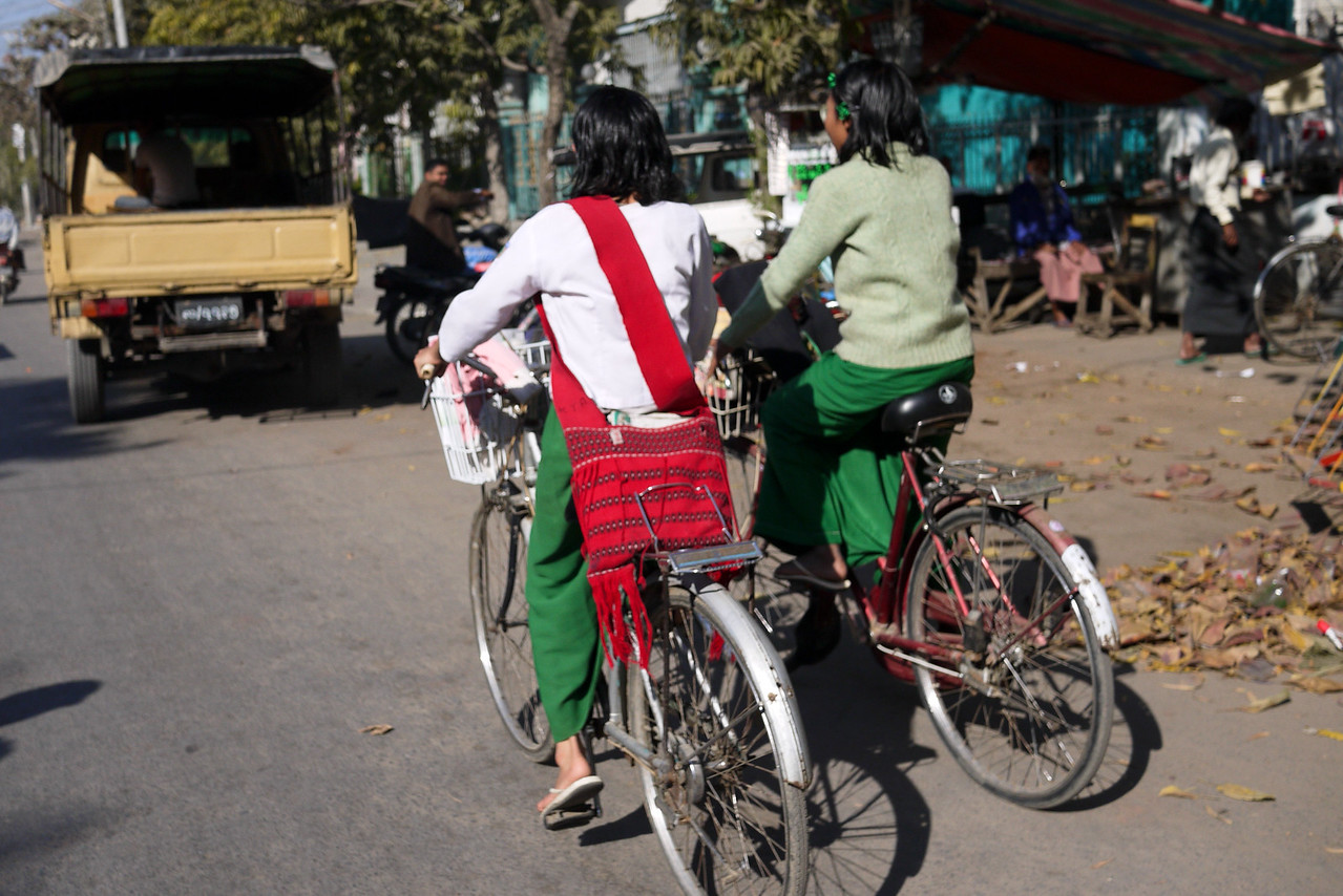 Cycling girls make their way home from school in Mandalay.