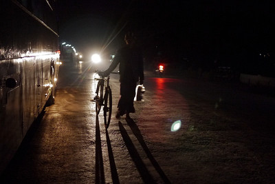 A lone biker makes his way on the dark road in Shwenyaung as I wait for the night bus to Mandalay.