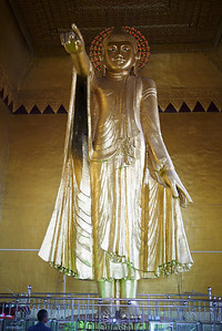 A Buddha statue pointing the path on Mandalay Hill, Burma.