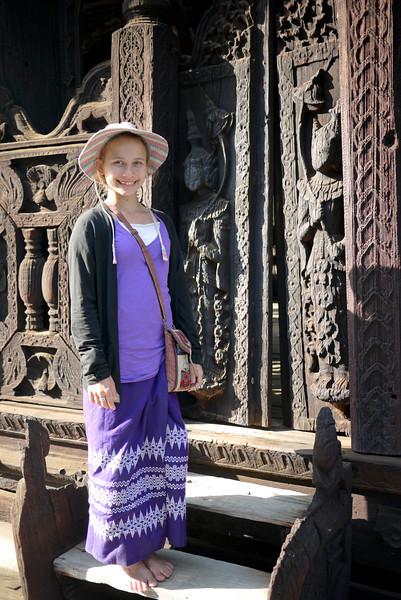 Ana poses in her longyi at the Bagaya Kyaung Monastery on Innwa (Ava) near Mandalay.