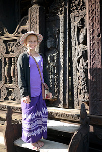 Ana poses in her longyi at the Bagaya Kyaung Monastery on Innwa (Ava) near Mandalay.