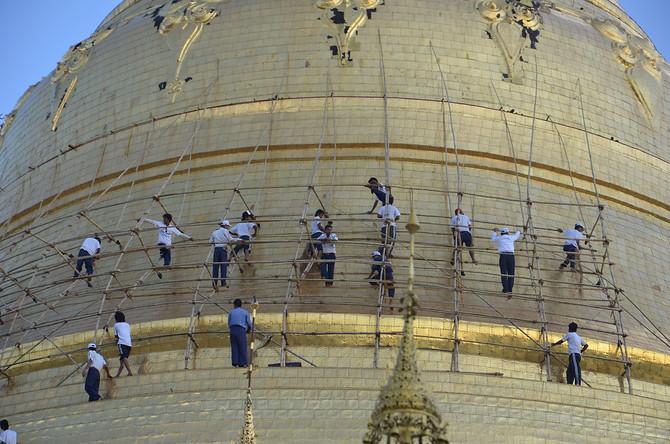 Reguilding the stupa