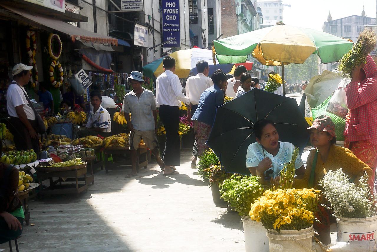 Flower and food vendors line the streets in Yangon, Burma (Myanmar)