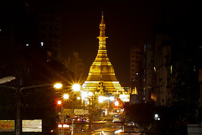 The shining gold of Sule Paya at night from an overpass in Yangon, Burma (Myanmar)
