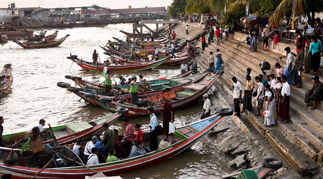 Boats leaving Yangon, Myanmar at sunset