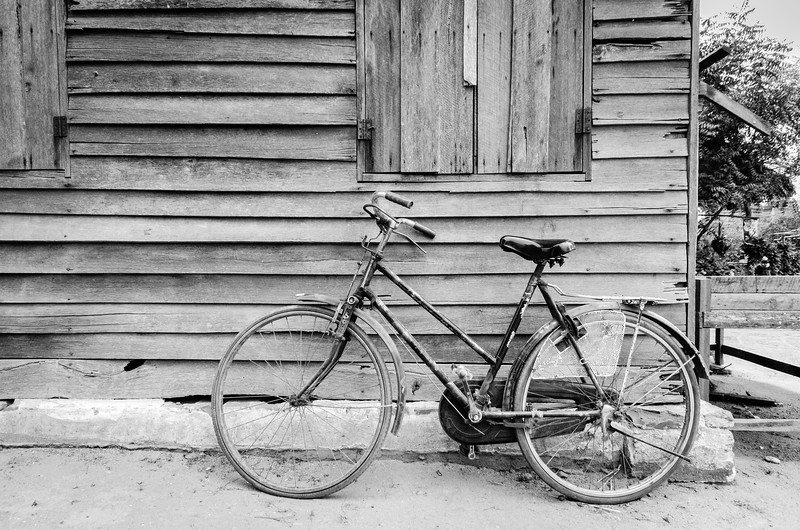 Bicycle against shed, Bagan.