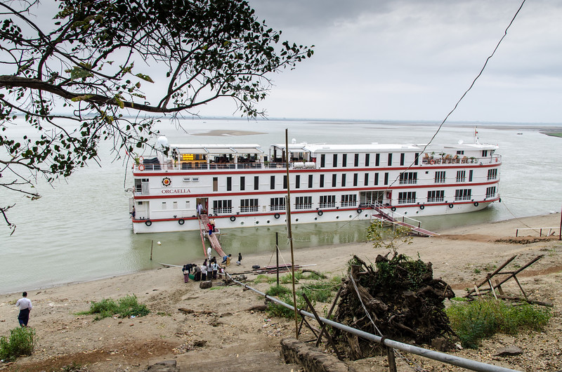 A cruise ship along the river bank near the teak monastery.