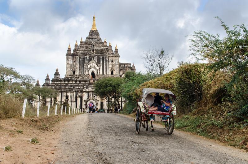 A horsecart approaching Thatbyinnyu Temple.
