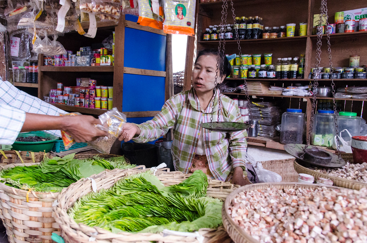 Woman selling betel nut in the market.