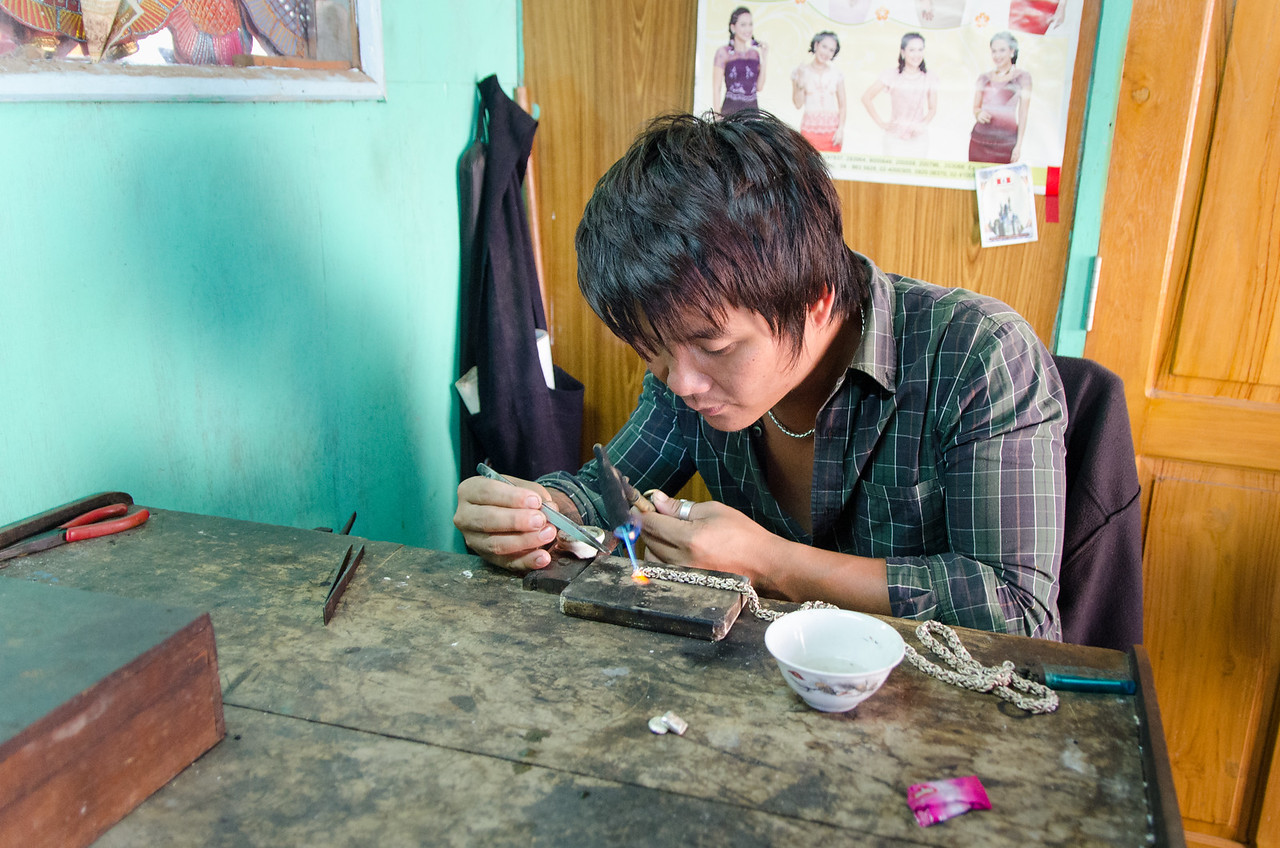 This guy is making an elaborate silver chain.
