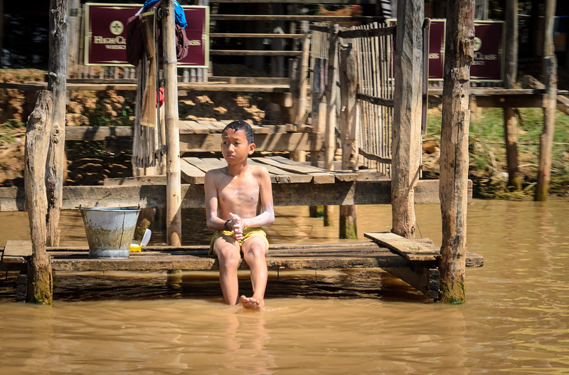 Boy bathing at the river.