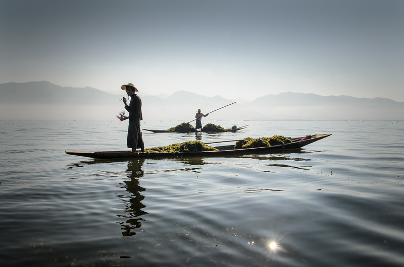 Seaweed gatherer on smoke break, Inle Lake.