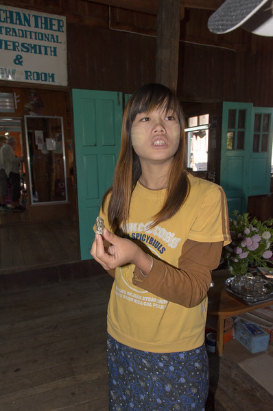 We are greated by this young lady at the Aung San Ther Silversmith in Ywama Village.