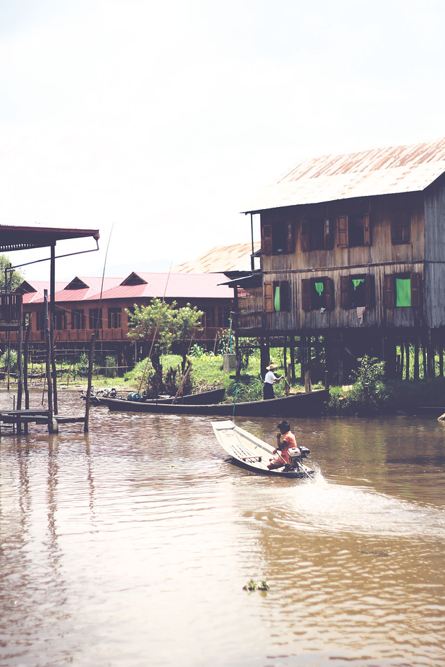All the houses on the lake are built on stilts. Locals use the canoes as transportation. April 2015