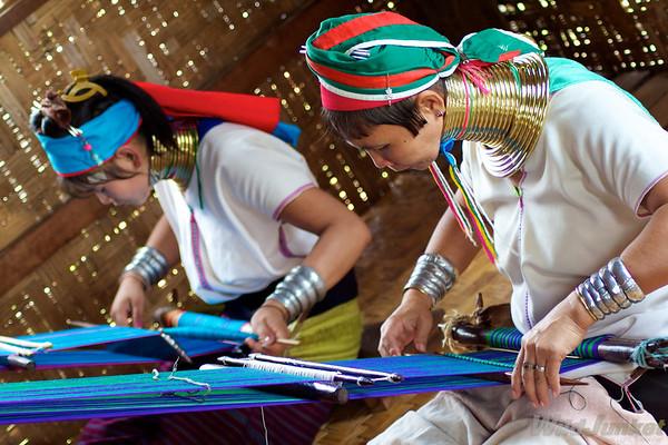 Karen women weaving cloth for visitors