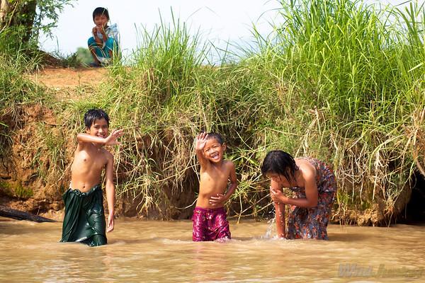 Kids taking a bath in the lake