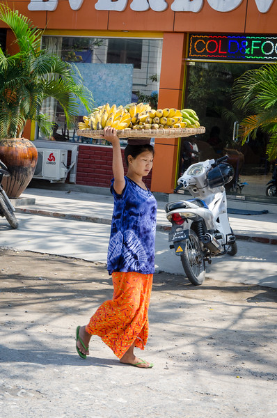 Lady with fruit.