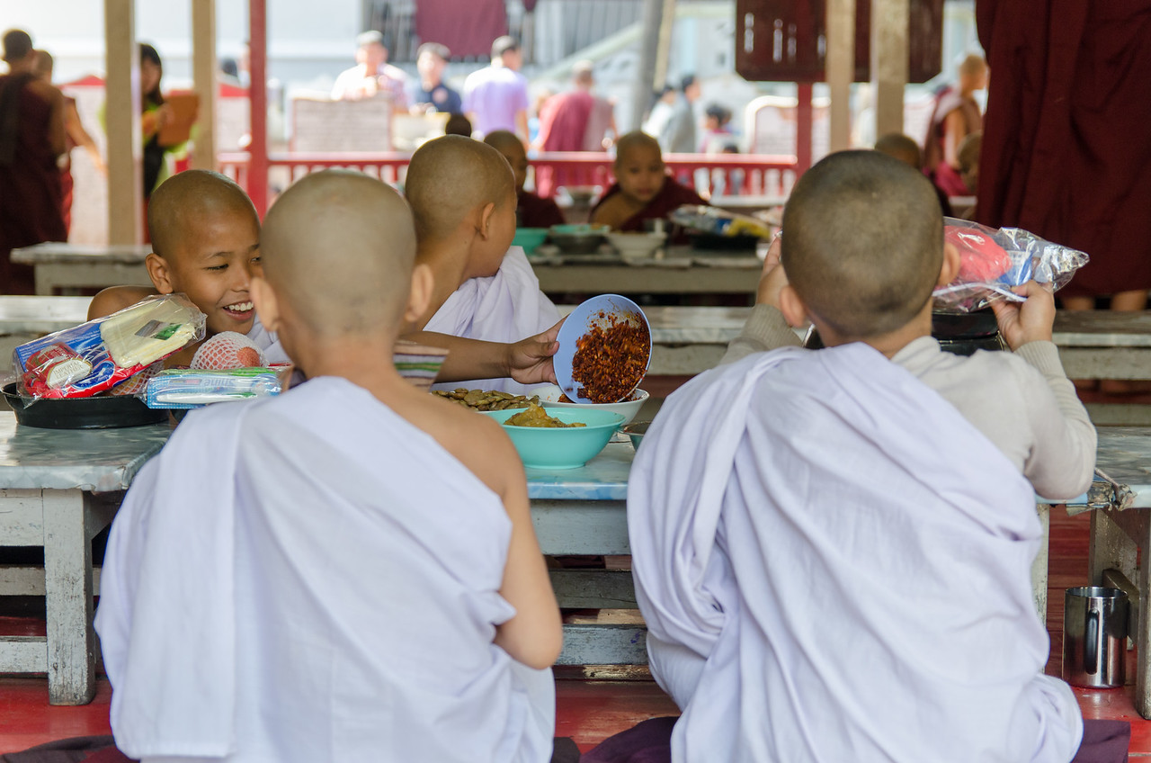 Young monks eating.