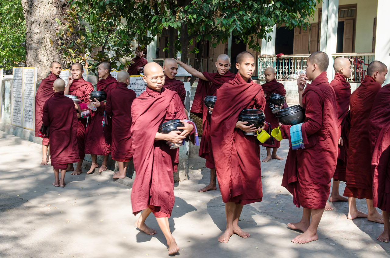 Monks about to line up for their morning meal.