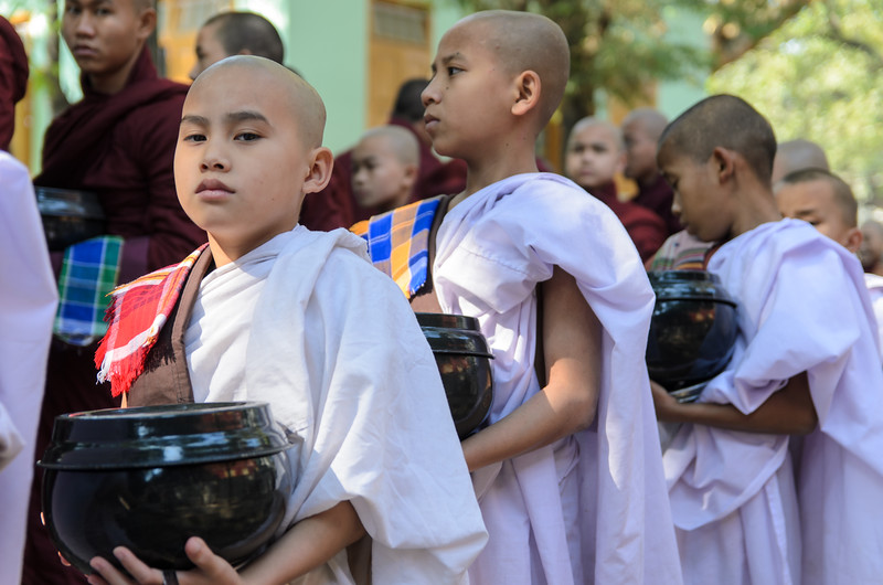 Young monks in line for their morning meal.