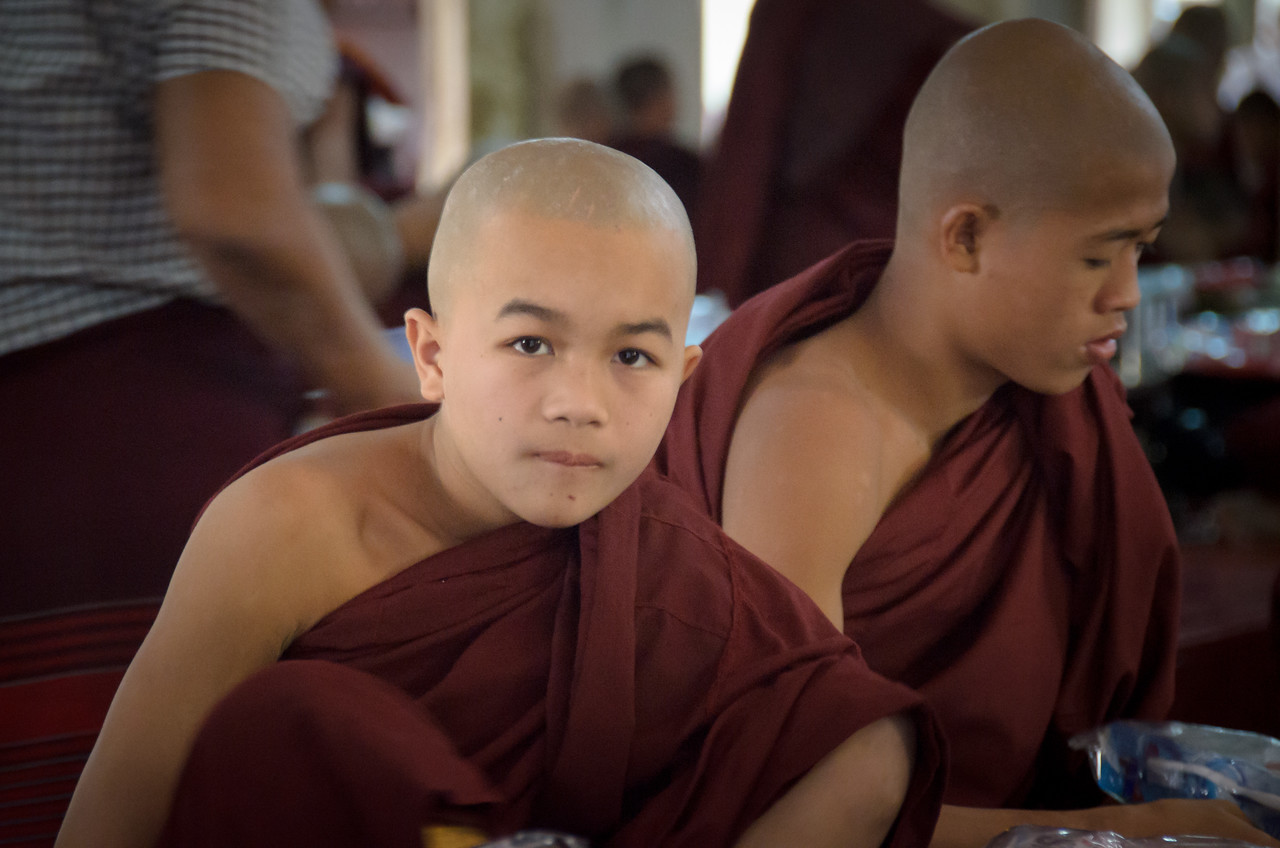 Young monk at breakfast.