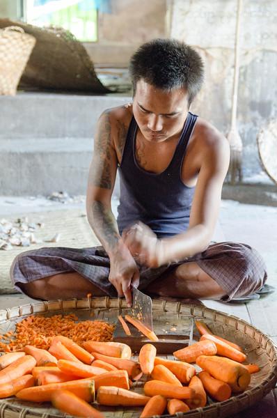 Man chopping carrots.