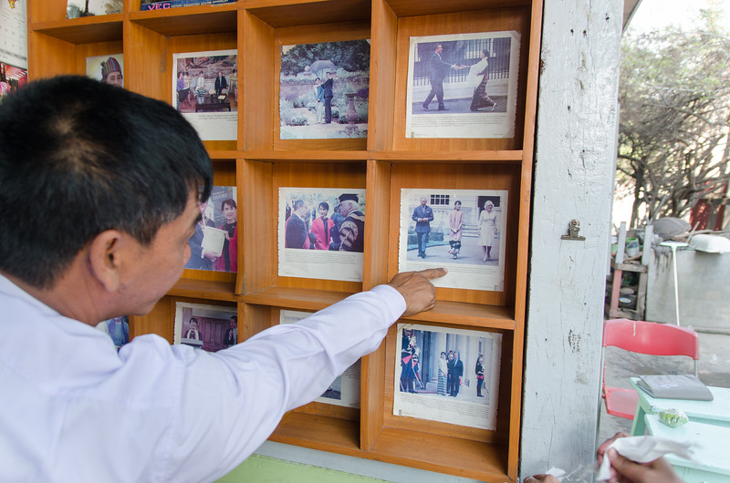 Joshua pointing out Aung San Suu Kyi wearing an outfit from the SHWE SIN TAI Silk House.
