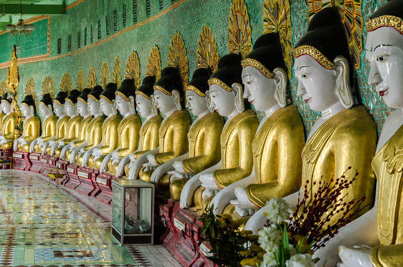 Umin Thounzeh (literally 30 Caves) is one of the more distinctive complexes on the main hilltop, a colorful crescent-shaped colonnade within which there are 45 Buddha images.